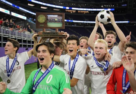 Members of the boys soccer team pose with the 1st trophy after winning the game 2-1 at the US Bank Stadium in Minneapolis.