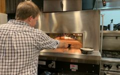 A wood-fire oven is used at Manger for a unique way of preparing their dishes. Owner Mike Willenbring is seen here cooking a cut of beef tenderloin on a skillet in the wood-fire oven.