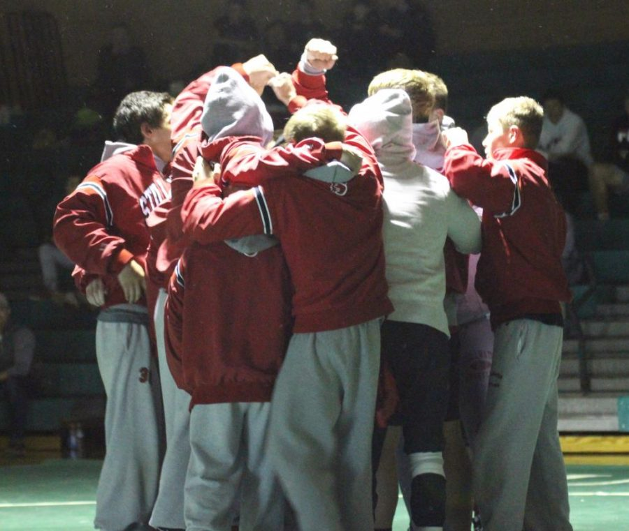 The wrestling team gets excited before wrestling in a meet. They wrestled and won, against their biggest rival, Mounds View, on Dec. 20 at Mounds View High School.
