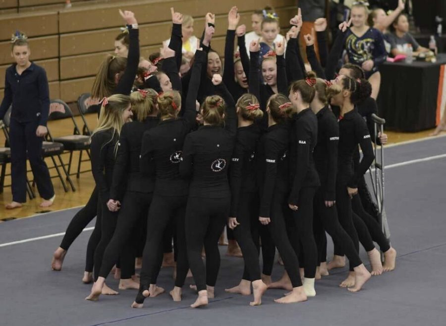 Girls+varsity+gymnastics+team+huddles+up+before+a+meet+against+White+Bear+Lake+on+Jan.+2.+They+are+hoping+for+another+state+title+this+season.
