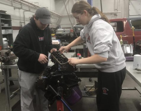 Students from the 916 career in tech program work on taking apart a car engine for their class. The 916 program keeps students more engaged in their learning compared to a normal classroom setting, which gives students a boost of experience going into college.