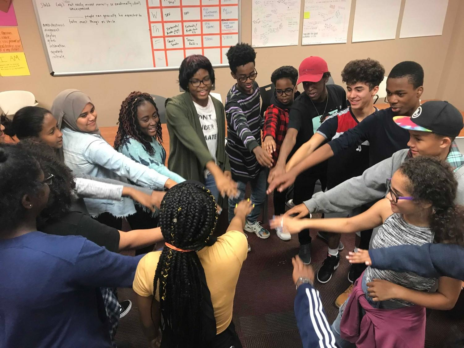 Members of the Black Student Union make a huddle to celebrate a successful meeting. These students form long-lasting bonds through a common ground.