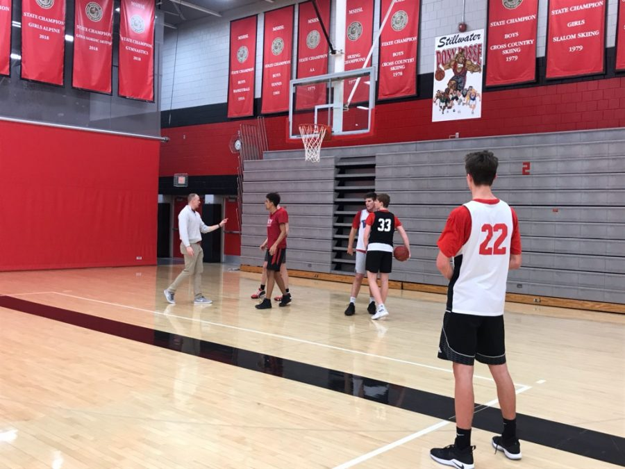 Boys basketball practices as coach Hannigan and coach Jordan give constructed feedback.