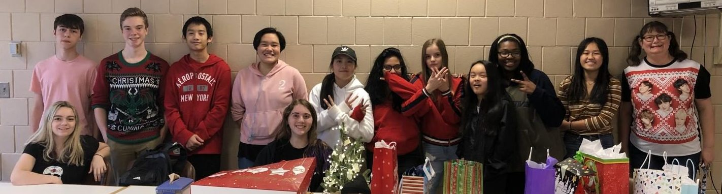 K-Pop club sets up for their end of semester party. They meet every Wednesday after school.