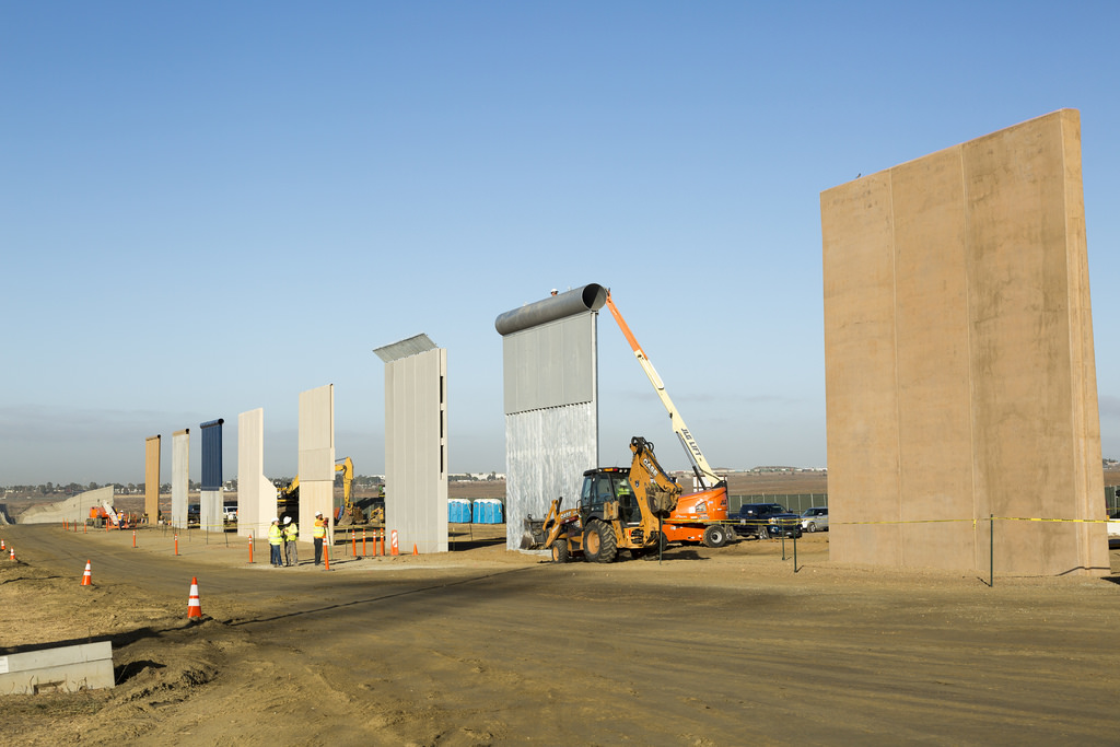 Construction of the wall in progress along the border. Only in some areas along the US/Mexican border is there a wall so far.
