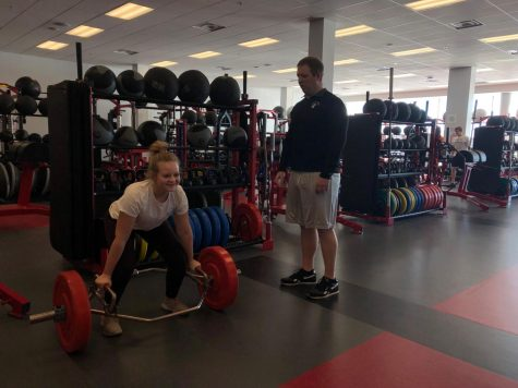 Chad Bischoff guides freshmen Caroline Monty through an exercise.