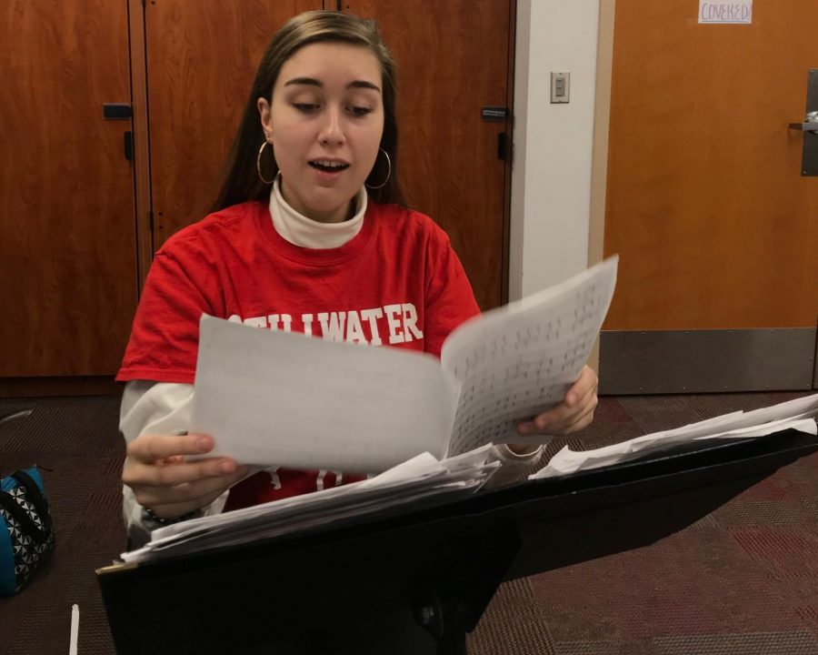 Senior Mya Lynse looks over a piece she has been working on. In her free time, Lynse works on new music that has not been created before.