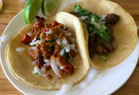 The two tacos pictured above are served at La Carreta Authentic Mexican Restaurant.  The taco on the left is Pastor (marinated pork) and the taco on the right is Asada (beef).  La carreta also serves Lengua (tongue) and Carnita (pork) tacos among other authentic flavors.