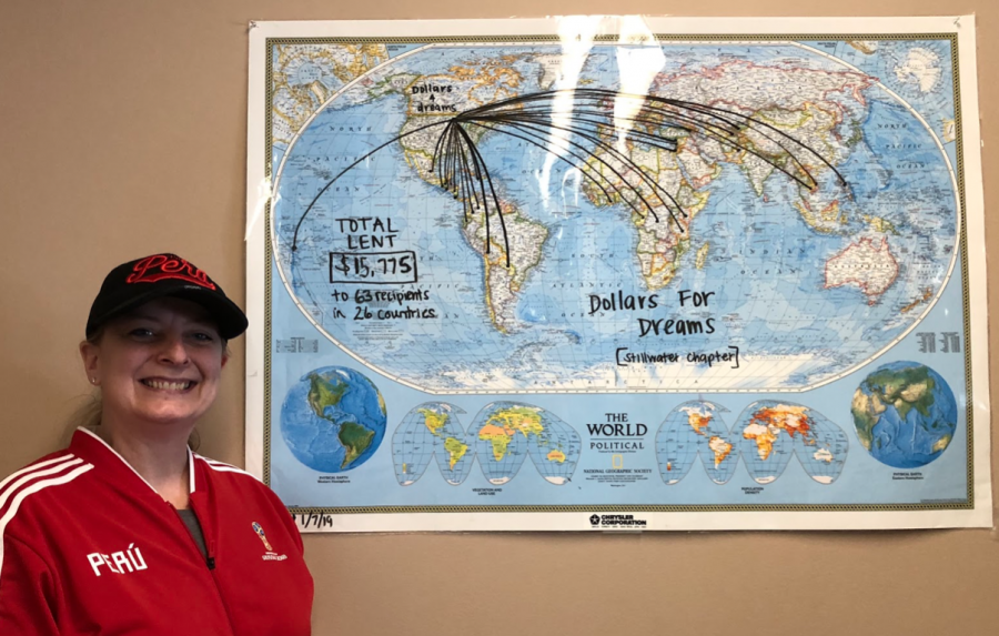 Dollars for Dreams displays a map in Spanish teacher Kirsten Carter's room to show where their loans go. Members started this map when the club first began three years ago. They have helped 63 different people in 26 countries.
