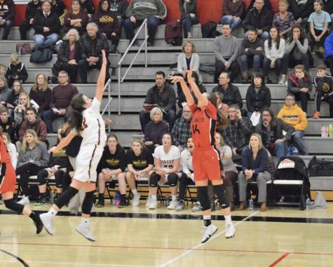 Senior Sara Scalia shoots a basket Dec. 7 during their game against Forest Lake. The girls won with a score of 59-52.