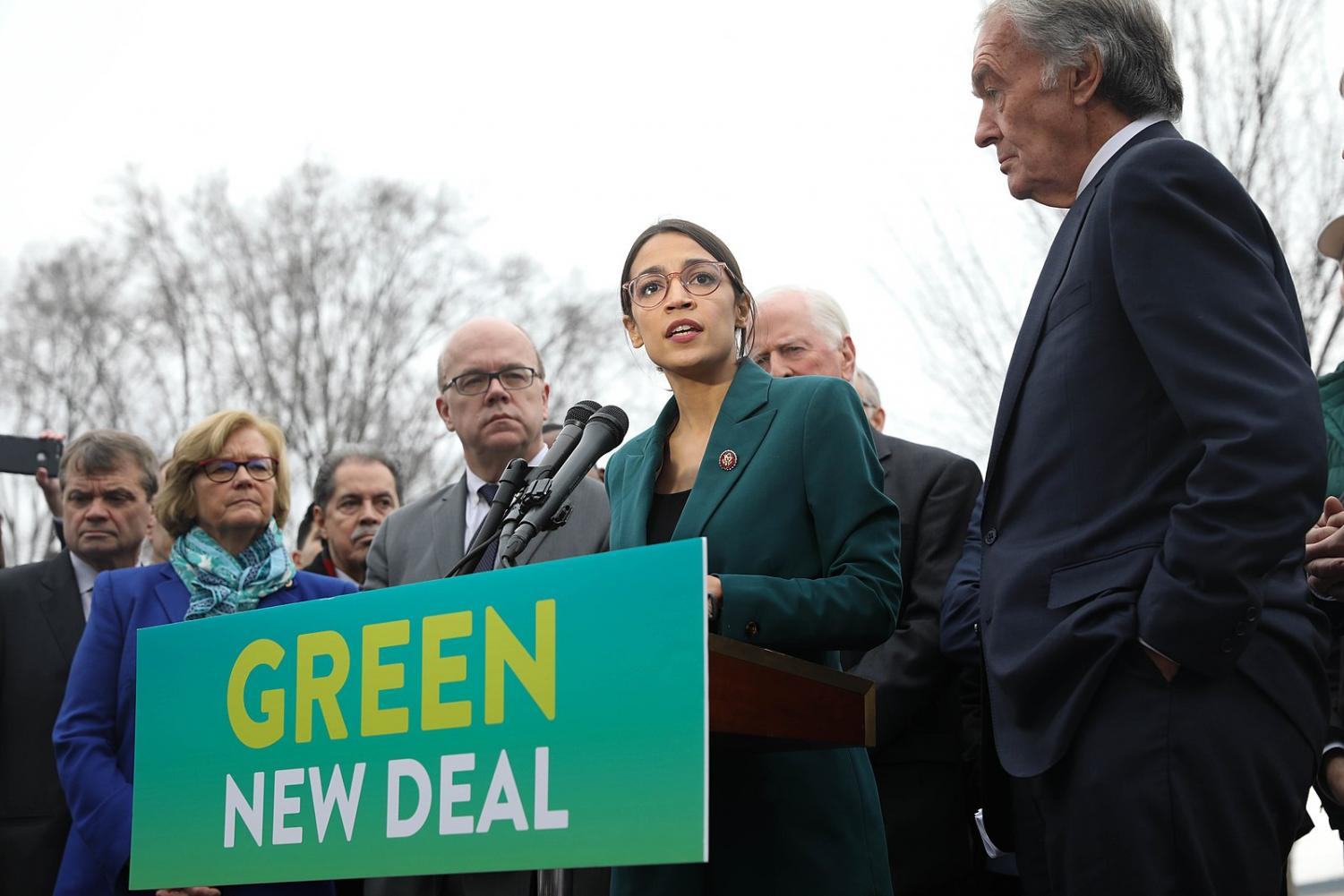 Rep. Alexandria Ocasio-Cortez, D-N.Y. (center) and Sen. Ed Markey, D-Mass. (far right) give a press release on their new resolution, the Green New Deal. The proposal's name is modeled after former president Franklin Delano Roosevelt's