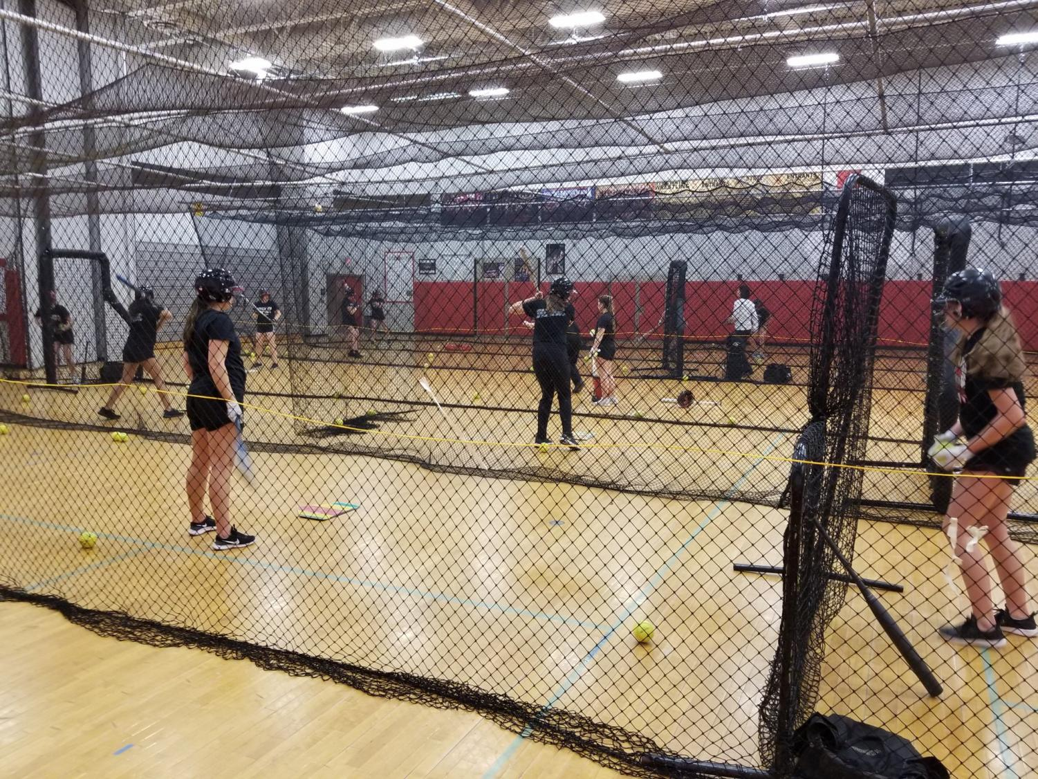 The girls softball team starts their season with indoor practice.
