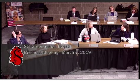 The School Board discusses their action items at the school board meeting. Staff development cuts passed 5-1, with Board Member Jennifer Pelletier (right) the only nay.