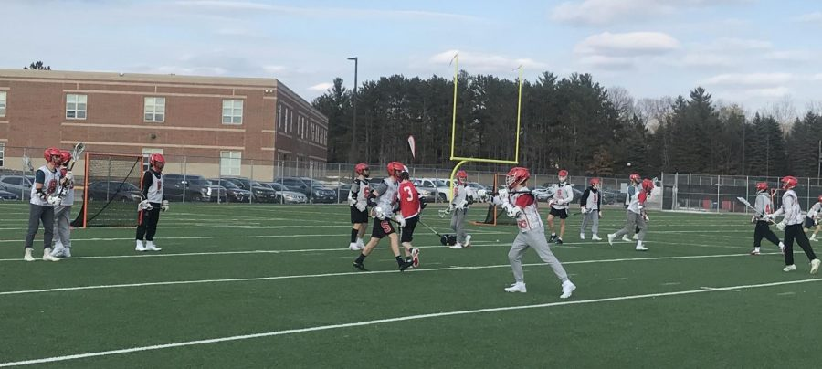 Boys lacrosse team practices for their upcoming season on the school's turf fields for captain's practice. They consistently work on their passing and catching.