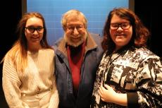 Eighth graders Berit Serle (left)  and Kennedy Tope (right)  had the exciting opportunity to have Fred Amram (middle) talk to their class about his experiences in the Holocaust.