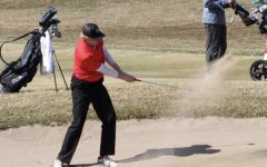 Senior captain Wyatt Wasko hits a sand shot during a conference match. The Ponies are a part of the Suburban East Conference and are joined by eight other teams from around the area.