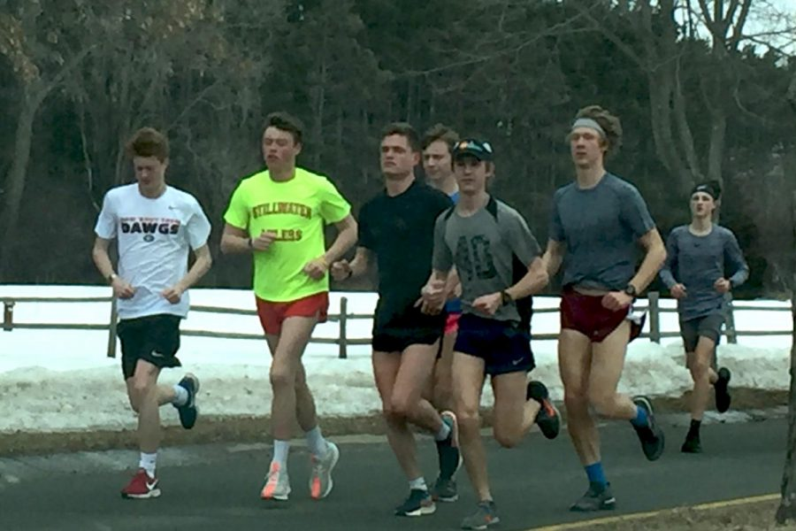 The+boys+track+team+trains+outside+in+the+cold+weather.+At+practice+they+run+long+distance+to+build+up+stamina.