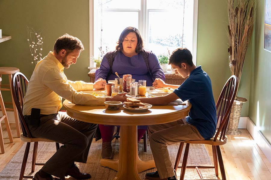 Fair use image by breakthroughmovie.com, the acting family of the Smith's partaking in daily prayer before breakfast. The first scene serves as an introduction to the main theme of faith.