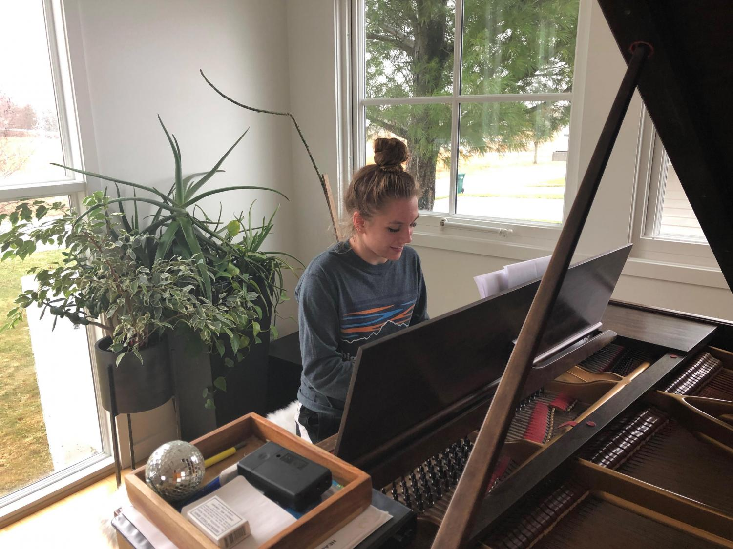 Sophomore Hannah Dettmann practices her musical selection she has prepared for coffee house.