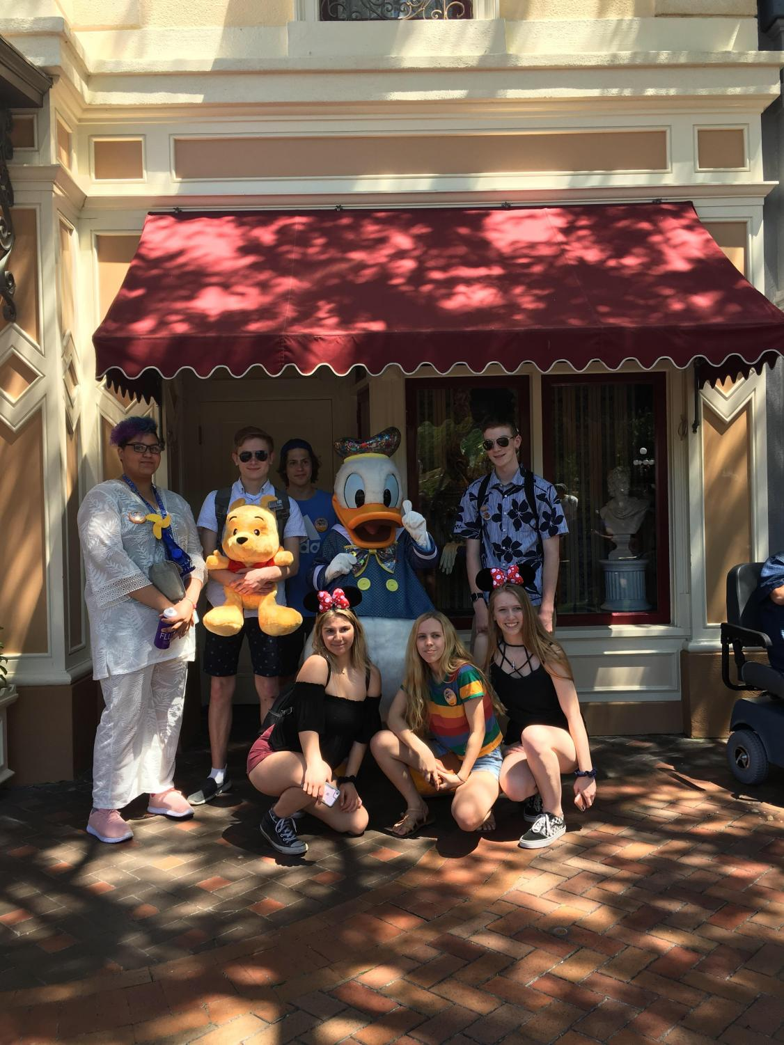 On+the+hunt+for+Disneyland+characters%2C+seven+of+the+Pony+Express+students+take+a+photo+with+Donald+Duck%2C+featuring+Winnie+the+Pooh.
