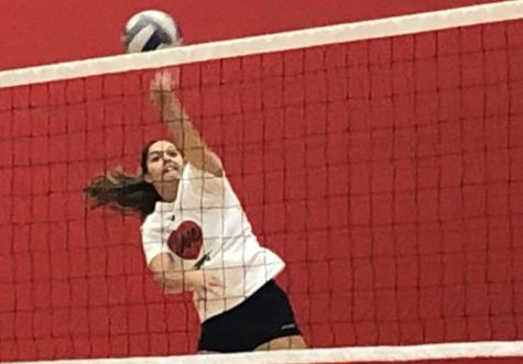 Junior Sydney Dejarnett goes for a kill during practice last Tuesday, Sept. 12. The team looks to improve their number of wins against Forest Lake on Tuesday.