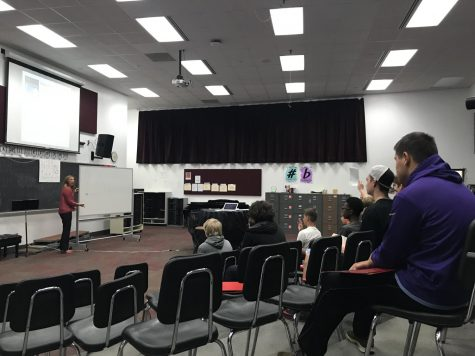 Choir Director Angela Mitchell leads vocal warm ups with basses before Tuesday sectionals. Each member of the Stillwater Choir is required to attend sectionals once a week at 7 a.m. before school.