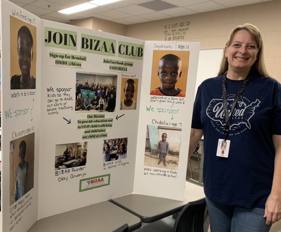 Kirsten Carter is showing off her BIZAA board. Listed on the poster are the kids that are being sponsored. Carter said she wants to continue this cub