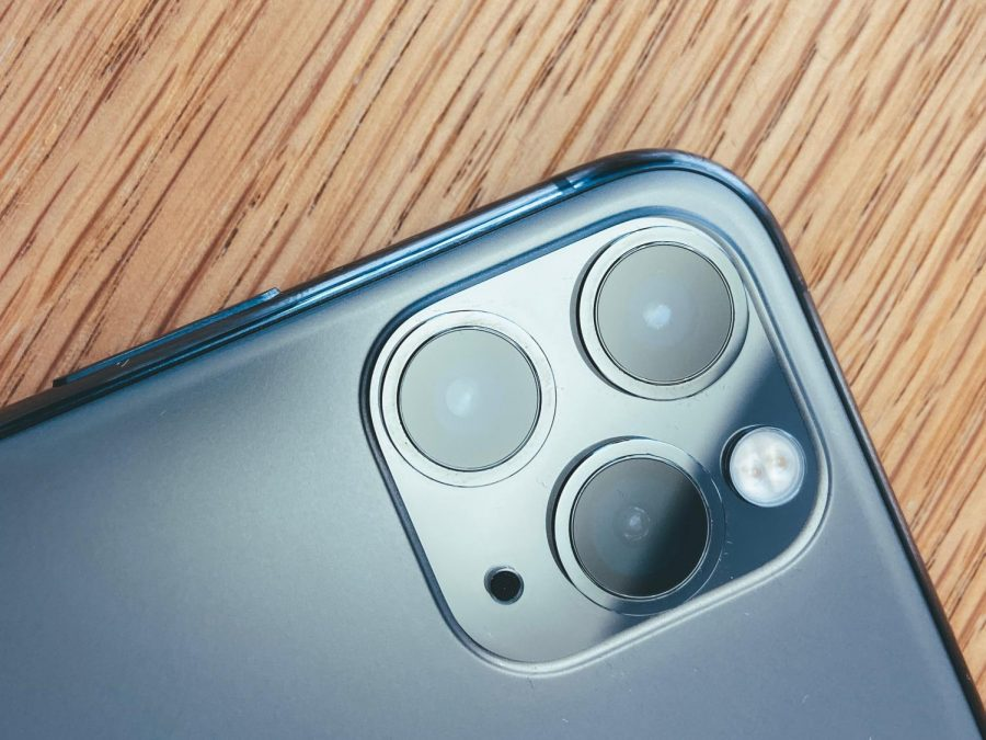 Apple's iPhone 11 has a telephoto (Lens with a longer focus length than standard), an ultra wide and a wide angle lens. The camera can now shoot in 4K and in slow motion.