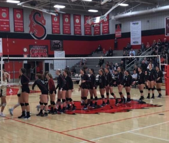 Stillwater varsity volleyball team warms up before their game against East Ridge Oct 1. The Ponies lost 13-25.