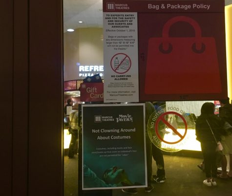 On the entrance doors to Marcus Theaters a new increased security bag policy goes into effect 3 days before the premier of 'Joker'. A sign also warns that no costumes are allowed during screenings of 'Joker', showing  the increased tension and cautiousness around the film.