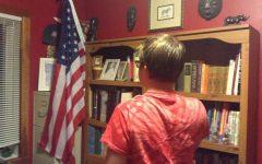 Sophomore Spenser Menard says the pledge of allegiance. The words