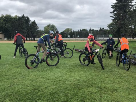 Members of the Mountain Biking team prepare for one of their daily practices. The team must take every available chance to practice to compensate for weather-based cancellations.