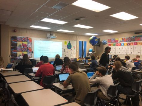Sara Damon helps her AP human geography students on a class assignment. Her experiences from the Fulbright scholarship helps her students who are struggling to complete their work.