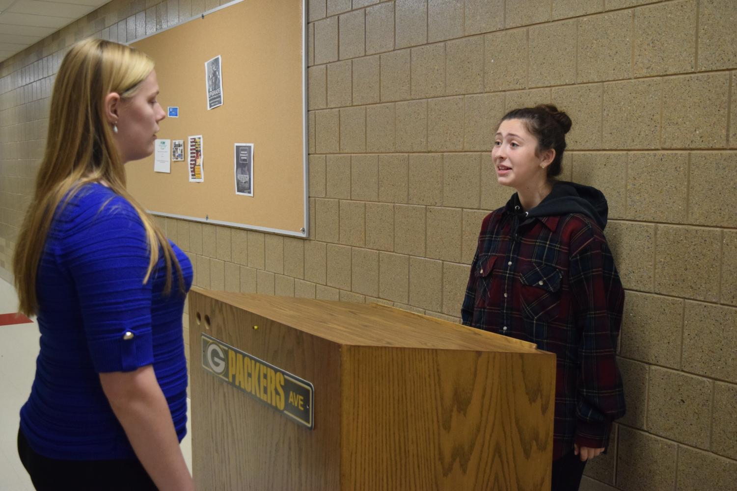 Allison Shore and Izzy Goetze are a power duo for the debate team. Their team has a new assistant coach, Laura Hammond. The girls are seen practicing in school on October 9th.