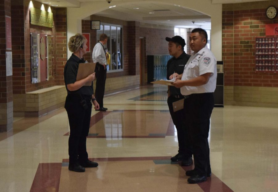 New security officers patrol the hallways during flex time Oct. 9. Officers ensure students know where they are going.