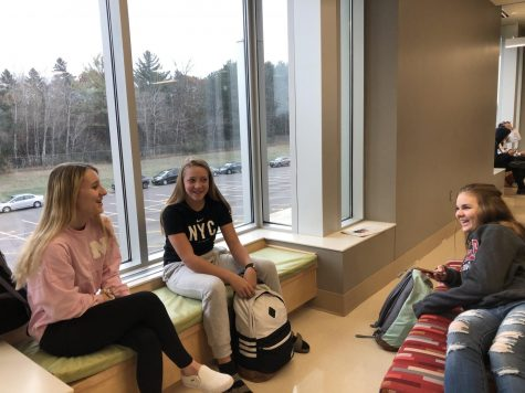 Freshmen Kendall Bajda, Eva Stafne, and Amelia Venzke hang out before the bell on a Friday morning. Rather than utilizing the Friday as a help day, they are waiting for the first bell to start their  seven hour school day.
