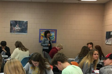 English teacher Kim Thompson talks with her English 10 students. She often works in small groups of students or up in the front of class.