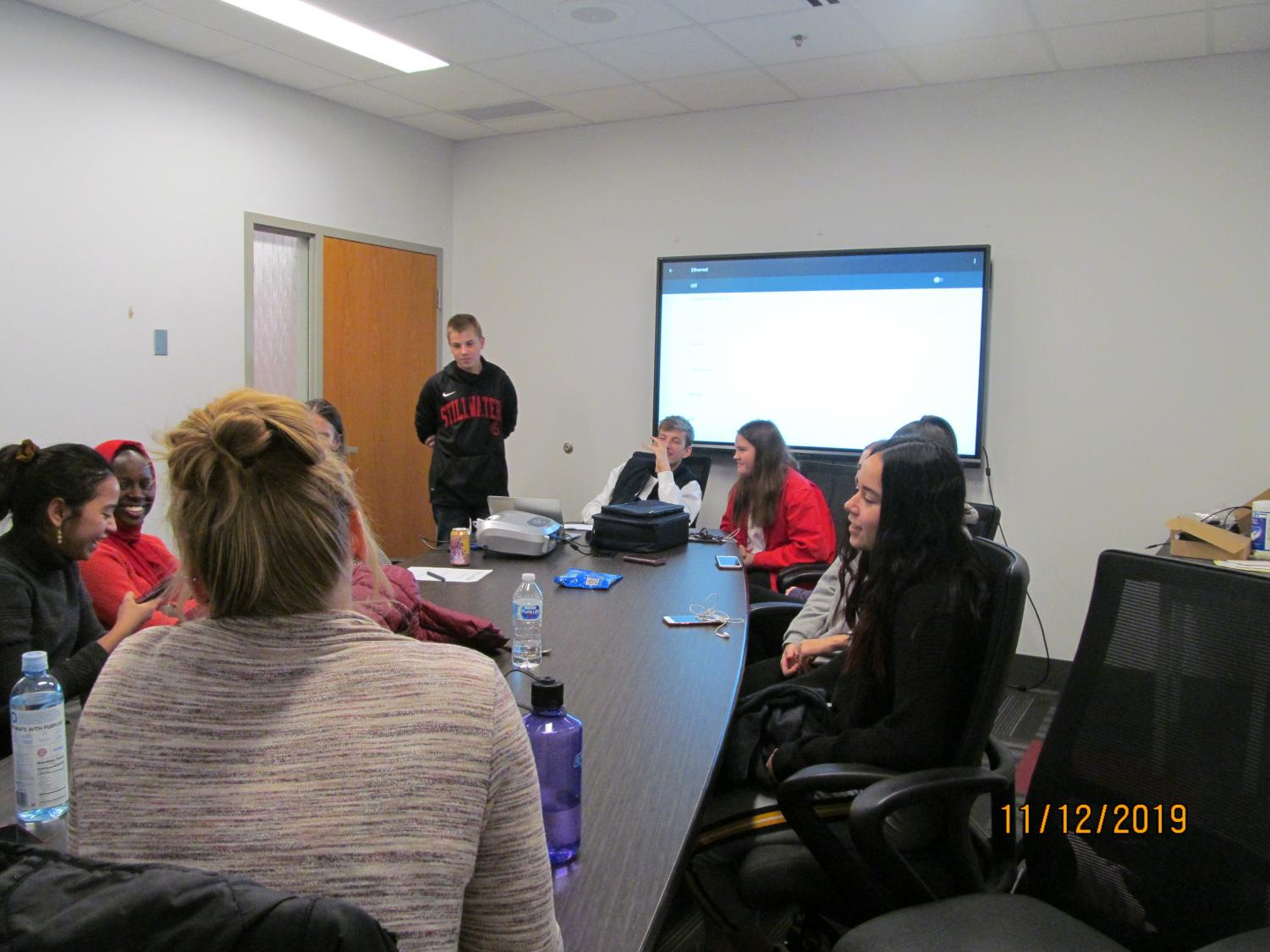 Foreign Exchange students meet to discuss how things are going and what people are doing. One student gave a presentation about Germany this month.