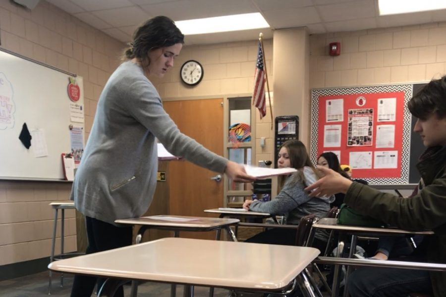 Students review their Precalculus unit test by going over frequently missed questions with math teacher Sara Biermaier during class time. MCA tests should be treated in the same respect, where teachers encourage studying by reviewing material with students.