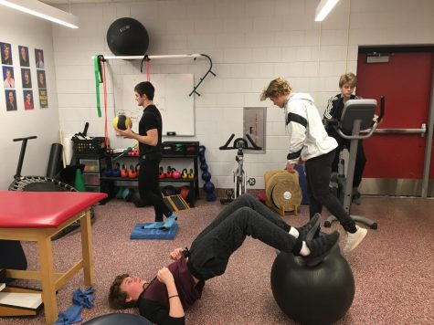Students utilize after school assistance from physical therapists Dec. 11 in the athletic training room. They are given exercises to complete throughout rehabilitation to build strength.