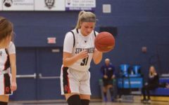 Senior Captain Grace Cote prepares to shoot free throws. The team beat Woodbury 97-69 Dec. 6.