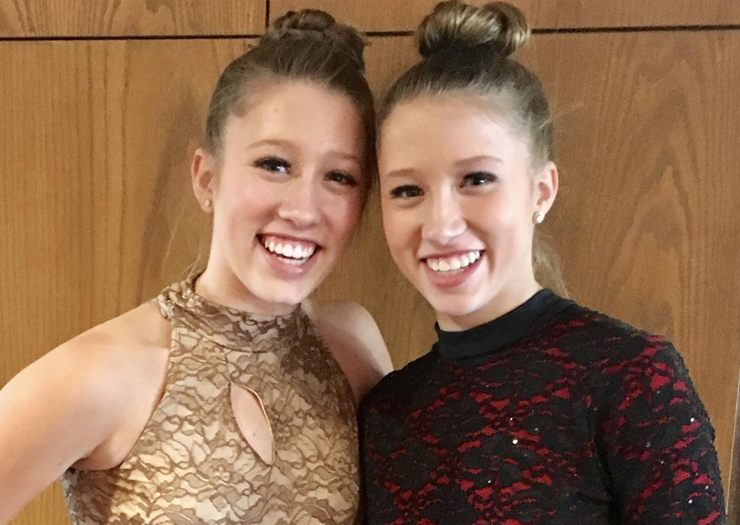 Sophomore twins Ava and Elise Karlstad pose for a picture after a dance recital in March. The twins dance at Inspiration Performing Arts Center (IPAC) in Mahtomedi.