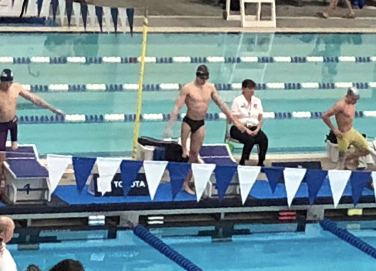 Junior Thomas Watry gets ready to swim at a competition in Texas. Watry swam in multiple national competitions held across the country, including North Dakota, Virginia and Oklahoma.