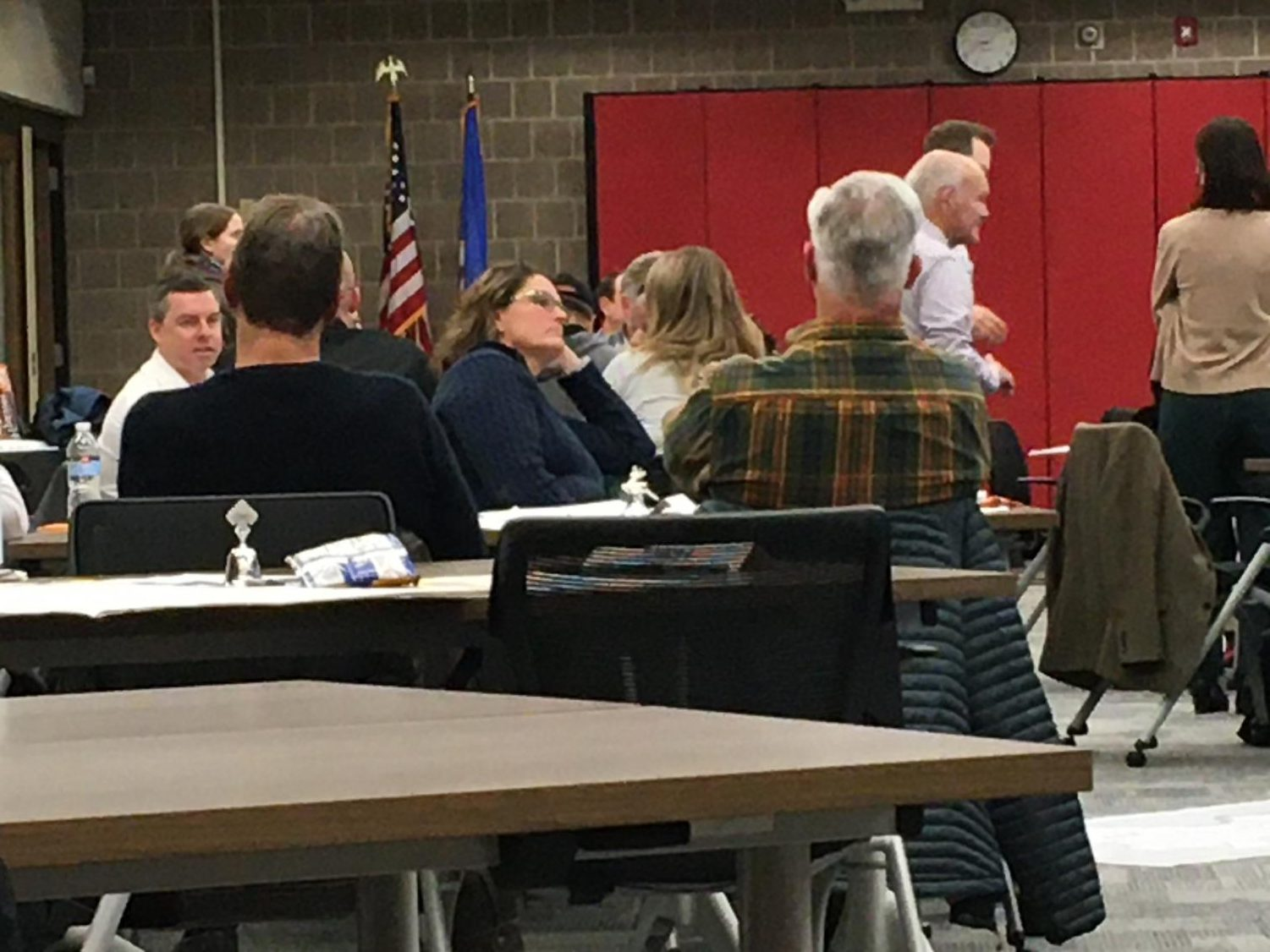 The Community Design Team discusses in small groups how to best use district facilities.  Each table is assigned a building to make specific recommendations for.