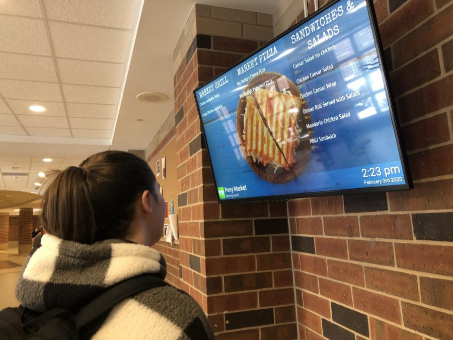 The daily lunch menu displayed in the school cafeteria exhibits meal options for the day. Students participate in diets, especially the keto diet, and struggle to find foods within their dietary restrictions.
