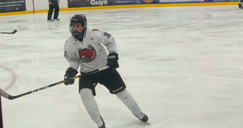 Freshman Ty Tuccitto plays his team's rival, Hill Murray at his home ice on Jan. 21. Tuccitto plays forward. He plays a big role in scoring goals.