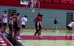 Boys Varsity basketball team practices after school from 3 p.m. until 5 p.m. As they prepare for their two games during the week, coach Hannigan pushes the team toward improvement.
