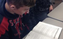 Junior Tyler Olson studies an ACT Prep Class textbook. Many students take time out of their classes to study for the ACT, which interferes with their focus and learning experience during class time.