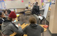 Students sit around a whiteboard in AVID as they help their classmate with a math problem. This activity is what AVID teachers call tutorials, the goal being to help students pick apart a question to determine what it is that they do not understand. Teachers believe that this strategy has benefits for all students.