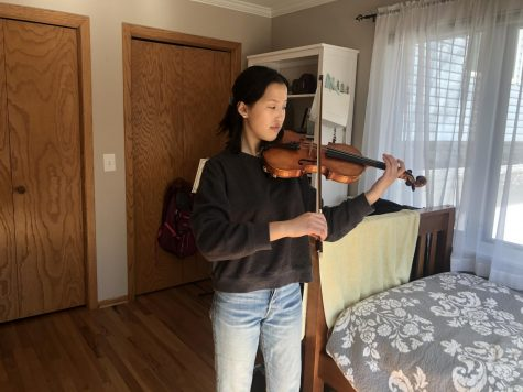 "Sophomore Katie Liss practices Max Bruch's ""Violin Concerto no. 1."" Concert Orchestra director, Zach Sawyer, due to distance learning constraints, will now have students input their goals for daily practice routine in a virtual practice journal."